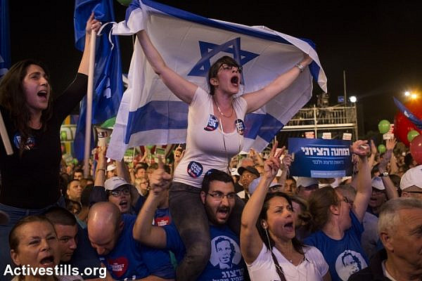 Israelis gather at a rally calling for a change of government and to replace Prime Minister Benjamin Netanyahu, at Rabin Square in Tel Aviv, March 7, 2015. (Oren Ziv/Activestills.org)