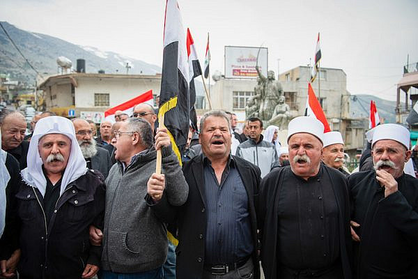 Members of the Druze community in the Golan Heights protest the decision of President Donald Trump to recognize Israeli sovereignty in the territory, Majdal Shams, March 23, 2019. (Basel Awidat/Flash90)