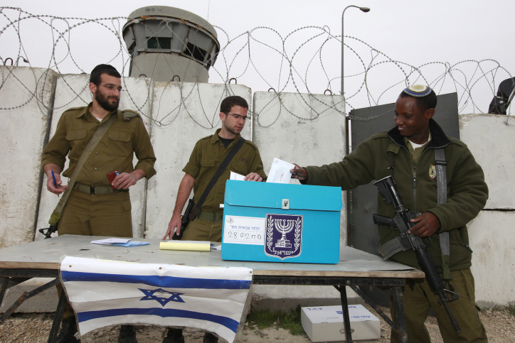 Illustrative photo of Israeli soldiers voting at a portable ballot box, near Bethlehem in the West Bank. (Nati Shohat/Flash90)