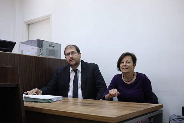Left-wing activist Anat Matar (right) seen alongside attorney Michael Sfard in the Jerusalem Magistrate's Court, April 28, 2019. (Oren Ziv/Activestills.org)