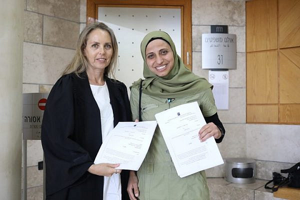 Dareen Tatour (right) and attorney Gaby Lasky seen at the Nazareth District Court after the court partially cleared Tatour of incitement to violence in a poem she published on Facebook, May 16, 2019. (Oren Ziv/Activestills.org)