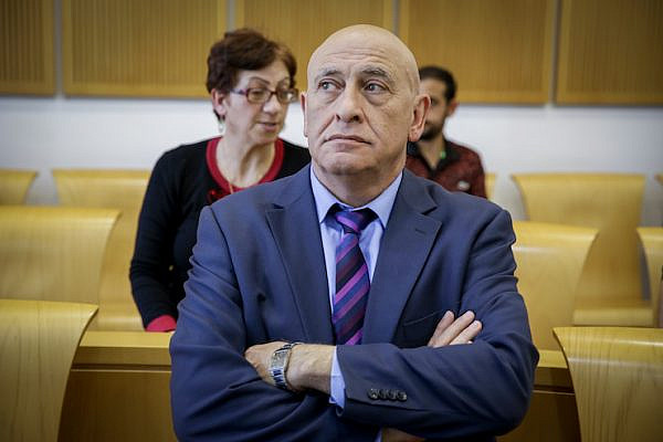 Former Balad MK Basel Ghattas arrives for a court hearing at the Be'er Sheva Magistrate's Court, April 9, 2017. (Yehuda Peretz/POOL)