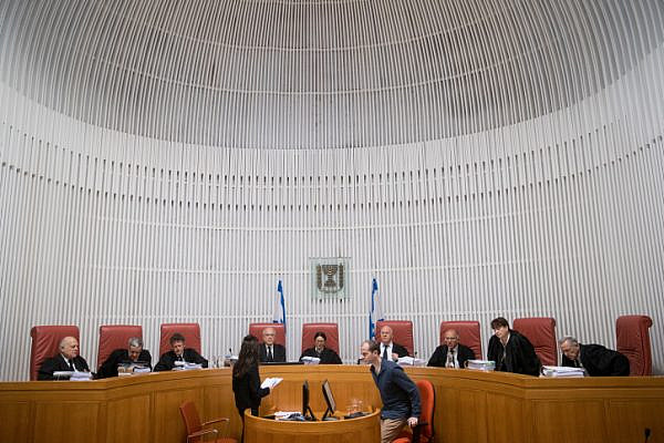 Supreme Court President Esther Hayut (C) and Judges of the Supreme Court arrive for a court hearing at the Supreme Court in Jerusalem, March 14, 2019. (Yonatan Sindel/Flash90)