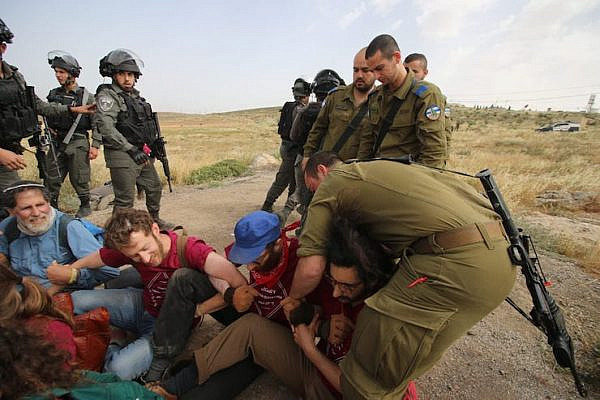 The Israeli army violently detained Palestinian, Israeli and international activists who were repairing an access road in the South Hebron Hills on May 3, 2019. (Ahmad al-Bazz/Activestills.org)