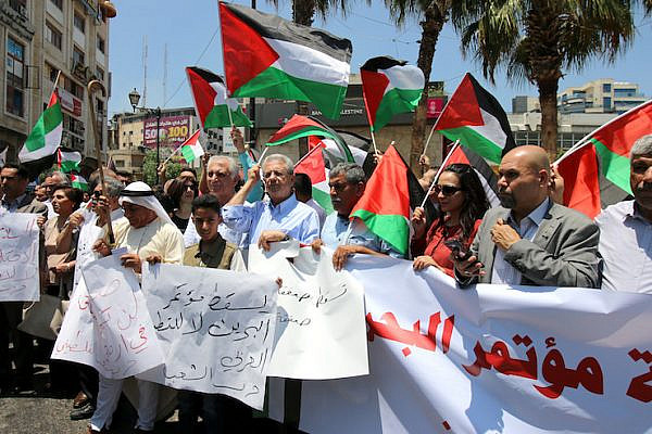 "Palestinians in Ramallah protesting the U.S.-led economic workshop, to be held in Bahrain as part of the Trump administration's ""Deal of the Century"" plan for ending the conflict, June 15, 2019. (Ahmad Al-Bazz/Activestills.org)"