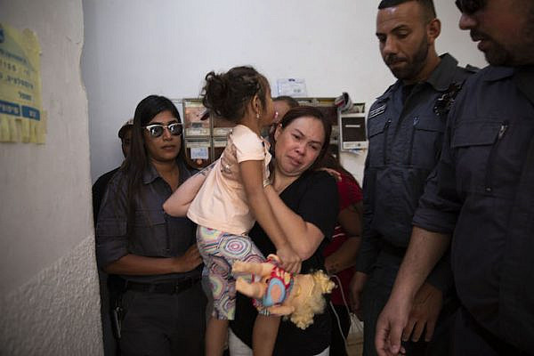 Israeli immigration agents arrest migrant worker Geraldine Esta and her daughters in their home in Ramat Gan, Israel, July 23, 2019. (Oren Ziv/Activestills.org)