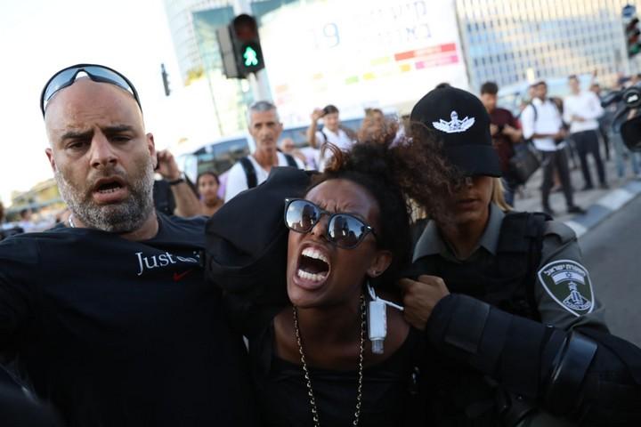 Israeli police officers arrest an Ethiopian Israeli demonstrator during a protest against police brutality and racism in central Tel Aviv, July 3, 2019. (Oren Ziv/Activestills.org)
