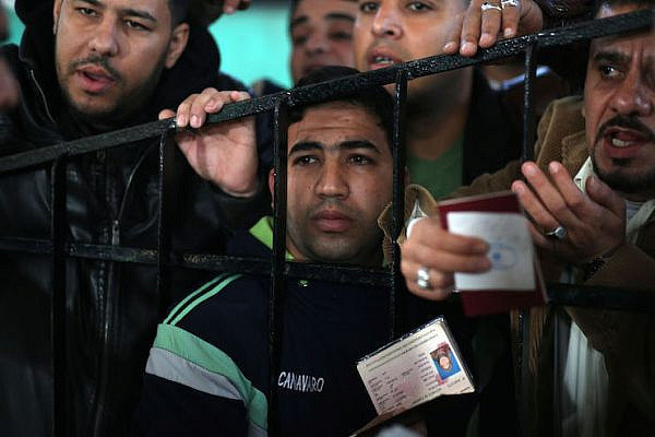 Palestinians wait at the Rafah border crossing with Egypt, in the southern Gaza Strip. (Mohammed Zaanoun)