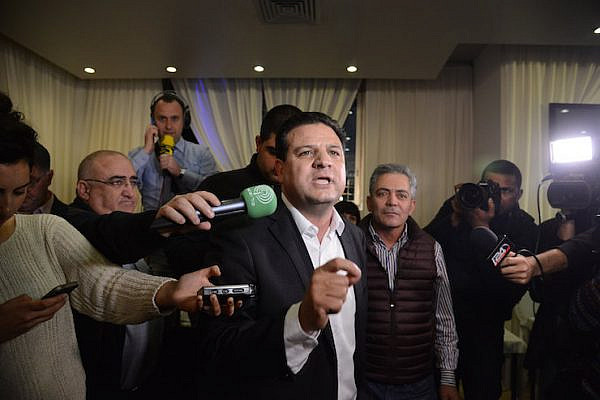 Ayman Odeh, head of the Joint List party, speaks to supporters at the party headquarters in Nazareth as the exit polls in the Israeli general elections for the 20th parliament are announced on March 17, 2015.  (Basel Awidat/Flash90)