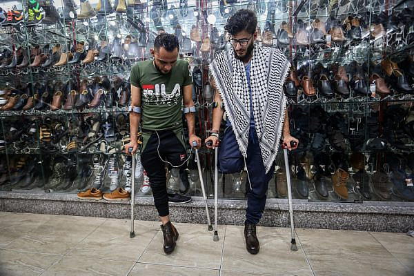 Young Palestinians Mohammed Ehsen, 21, Bassem Abu Ubaid, 33 , who had their legs amputated following injuries during the Great Return March, Gaza Strip, on June 3, 2019. (Abed Rahim Khatib/ Flash90)