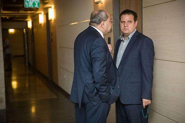 Leader of the Joint List Ayman Odeh (R) and party member Ahmad Tibi arrive for a meeting with party members at the Knesset on September 22, 2019. (Yonatan Sindel/Flash90)