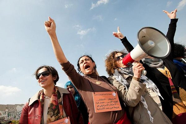 Palestinian women, joined by Israeli and international solidarity activsits, march to the Qalandiya checkpoint during a protest against the Israeli occupation on International Women's Day, West Bank, March 8, 2012. (Ryan Rodrick Beiler/Activestills.org)