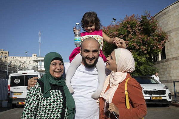 The family of East Jerusalem resident Mustafa al-Haruf greets him upon his release from Givon prison after nine months of detention, on October 24, 2019. (Oren Ziv/Activestills.org)