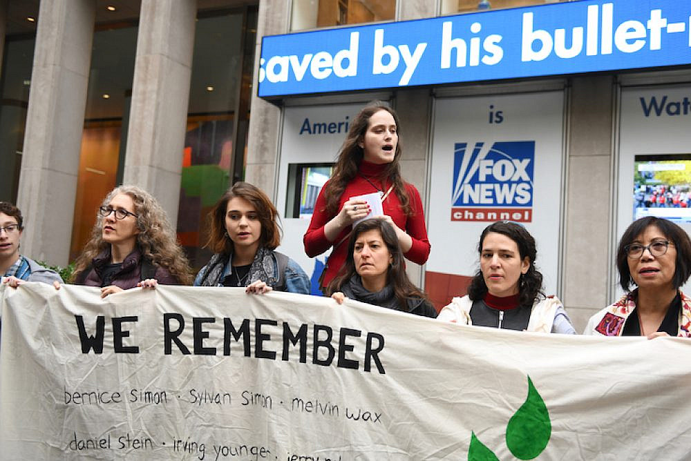 Author and activist Abby Stein speaks at a protest outside Fox News HQ held to commemorate the first anniversary of the Pittsburgh synagogue shooting, New York, October 25, 2019. (Gili Getz)