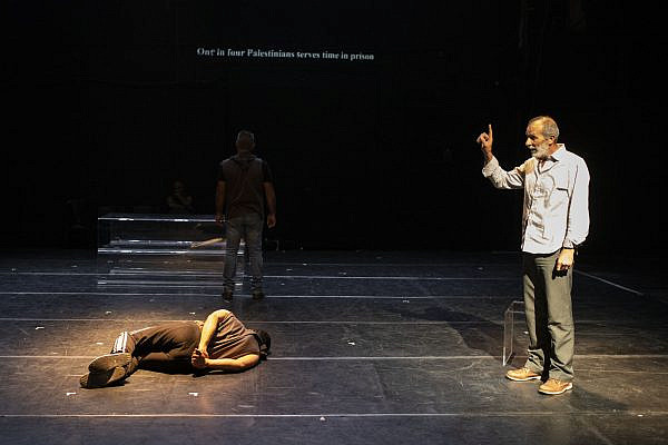 Einat Weitzman's 'Prisoners of the Occupation' tells the story of daily life in prison for Palestinians, with the actors reenacting interrogations, hunger strikes, family visits, and solitary confinement cells. (Oren Ziv)