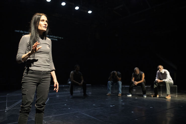 Einat Weitzman (left) performs in her documentary play, 'Prisoners of the Occupation,' which tells the story of daily life in prison for Palestinians. (Oren Ziv)