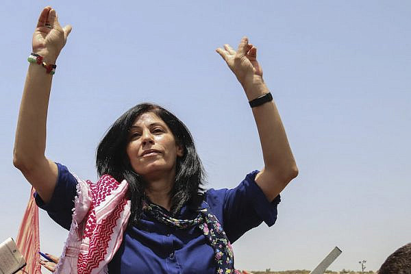Palestinian lawmaker Khalida Jarrar of the Popular Front for the Liberation of Palestine (PFLP) upon her release from an Israeli prison, at a checkpoint near the West Bank town of Tulkarem, June 3, 2016. (Haytham Shtayeh/Flash90)