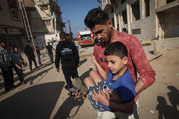 Palestinians evacuate  the wounded from Israeli air strikes in Gaza City on November 12, 2019. Earlier in the day an Israeli air strike killed Palestinian Islamic Jihad field commander Baha Abu Al-Atta. (Fadi Fahd/Flash90)