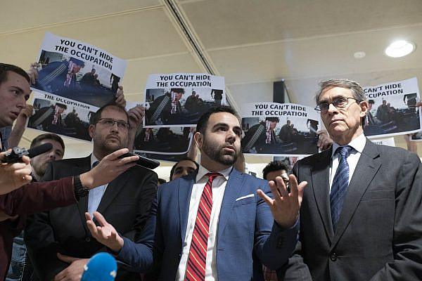 Human Rights Watch Israel and Palestine Director Omar Shakir speaks to press ahead of his deportation from Israel, flanked by HRW head Kenneth Roth, right, and attorney Michael Sfard, left, November 25, 2019 (Oren Ziv/Activestills.org).