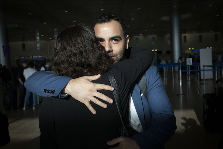 Human Rights Watch Israel and Palestine Director Omar Shakir parts with friends and supporters at Ben-Gurion Airport ahead of his deportation from Israel, November 25, 2019 (Oren Ziv/Activestills.org).