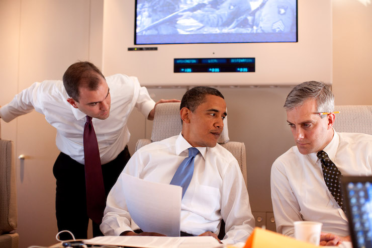 President Barack Obama confers about the Cairo speech with Deputy National Security Advisor for Strategic Communications Denis McDonough, right, and speechwriter Ben Rhodes on Air Force One en route to Cairo, Egypt, June 4, 2009. (Official White House photo by Pete Souza)