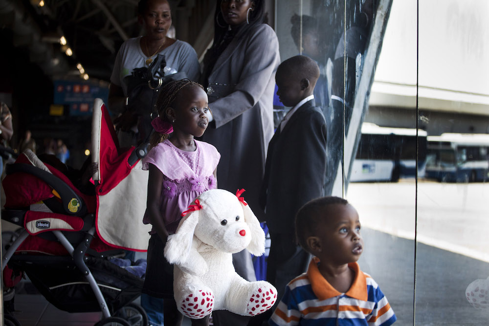 South Sudanese refugee children prepare to board a bus from Tel Aviv's central bus station to Ben Gurion Airport, before their deportation to South Sudan, June 17, 2012. (Oren Ziv/Activestills.org)