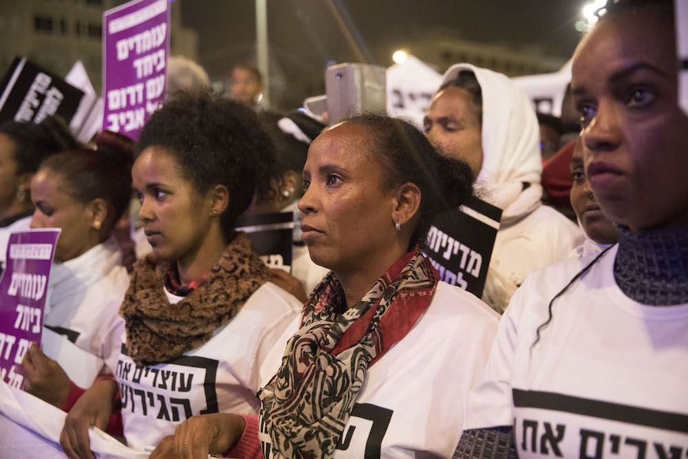 Asylum seekers take part in a massive protest in south Tel Aviv against Israel's plant to deport African refugees to Uganda and Rwanda, January 2018. (Oren Ziv/Activestills.org)