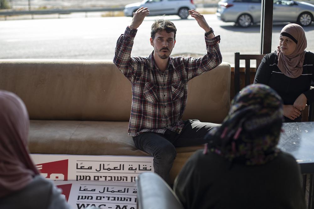 WAC-MAAN representative Yoav Tamir speaks to Palestinian workers on strike during a solidarity meeting in Almog junction, West Bank, December 5, 2019. (Activestills.org)