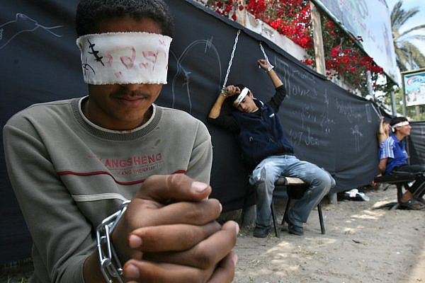 Palestinian boys dressed up as prisoners protest for the release of Palestinian prisoners being held in Israeli jails, Gaza City, April 21 2007. (Ahmad Khateib/ Flash90)