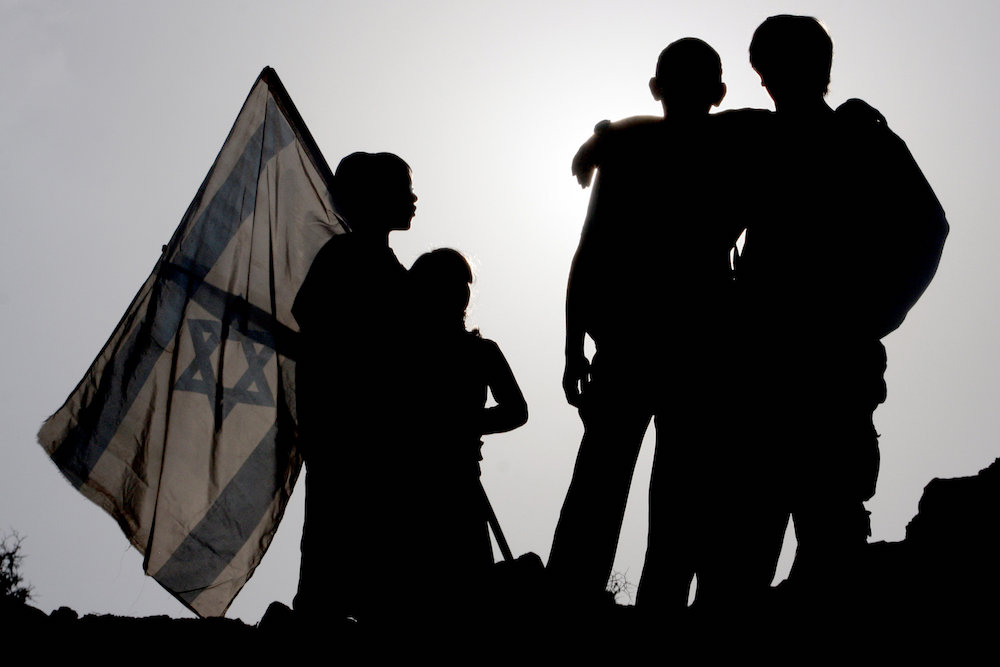 Jewish settlers gather on a hill in E-1 area near the settlement of Ma'ale Adumim, December 9, 2007. (Nati Shohat/Flash 90)