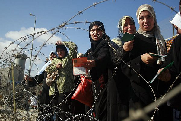 Illustrative photo of Palestinian women standing in line as they try to pass through Qalandiya checkpoint, which separates the West Bank city of Ramallah from Jerusalem. (Issam Rimawi/Flash90)