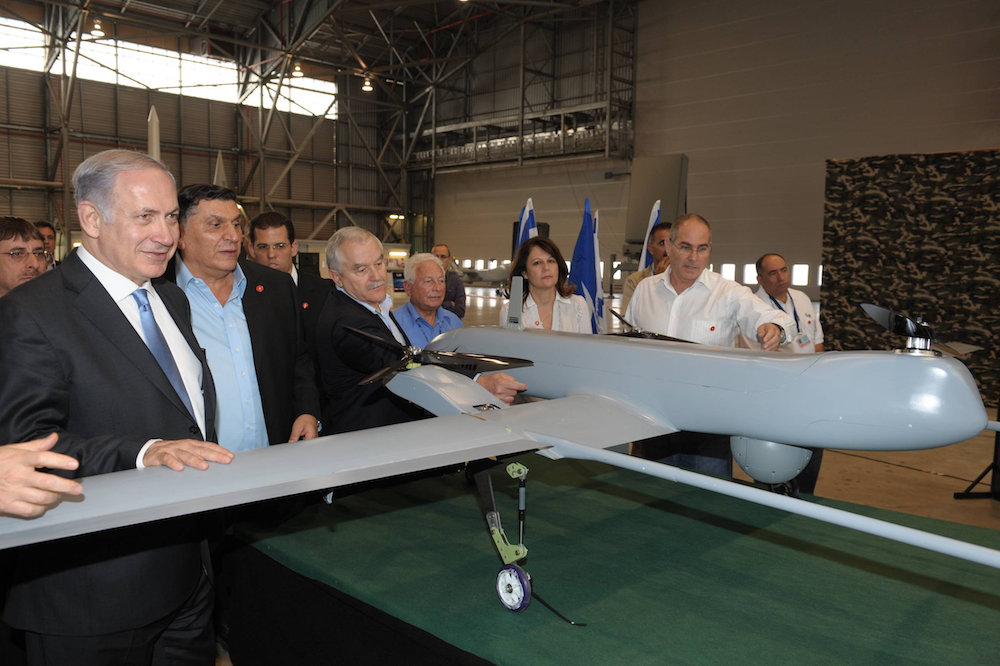 Prime minister Benjamin Netanyahu seen during a tour of the Israel Aerospace Industries, November 23, 2010. (Amos Ben Gershom/GPO)
