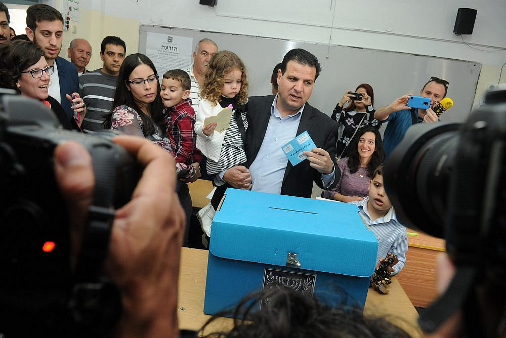 Leader of the Joint List, Ayman Odeh, casts his vote at a ballot station in Nazareth on election day for the 20th Knesset, March 17, 2015. (Basal Awidat/Flash90)