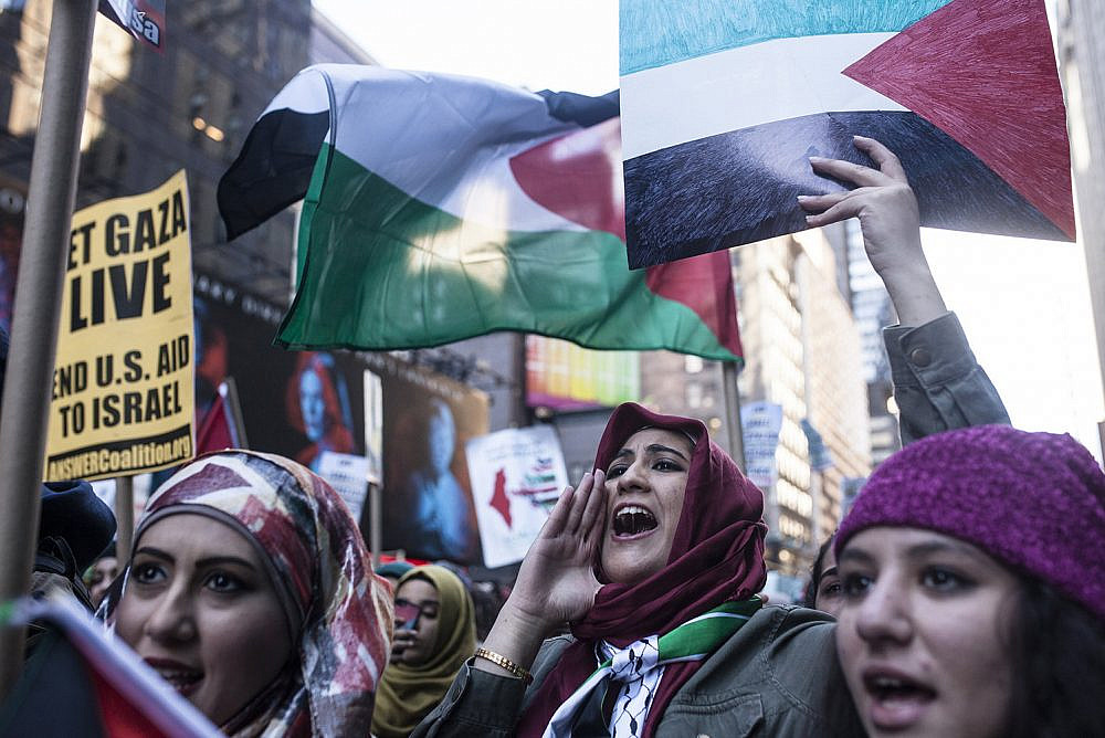 Pro-Palestine demonstrators march in Times Square, New York, October 18, 2015. (Amir Levy/Flash90)