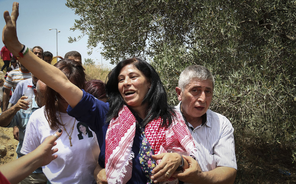 Palestinian Parliament member Khalida Jarrar of the Popular Front for the Liberation of Palestine seen after her release from an Israeli prison, Jabara checkpoint near the West Bank town of Tulkarem, June 3, 2016. (Haytham Shtayeh/Flash90)