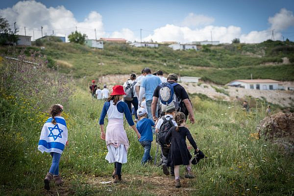 Israeli settlers seen celebrating Israeli Independence Day near the outpost of Havat Gilad, West Bank, May 9, 2019. (Hillel Maeir/Flash90)