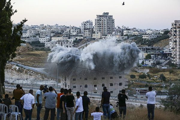 A Palestinian building is blown up by Israeli forces in the village of Sur Baher, East Jerusalem, July 22, 2019. (Wisam Hashlamoun/Flash90)