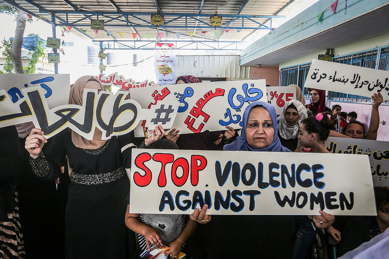 Palestinian women protest against violence against women organized by the Center for Women's Programs in Rafah in the southern Gaza Strip, on September 26, 2019. (Abed Rahim Khatib/Flash90)
