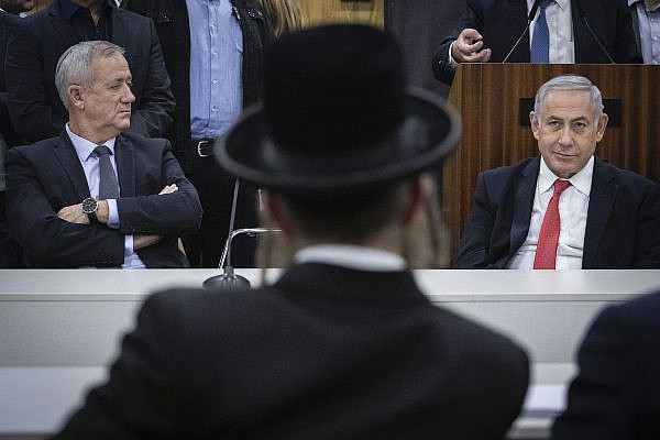 Shas party chairman and Minsiter of Interior Affairs Aryeh Deri, Prime Minister Benjamin Netanyahu, and Blue and White leader Benny Gantz at a ceremony marking six years to the death of Rabbi Ovadia Yosef, the late religious spiritual leader of Israel's Sephardic Jews, at the Knesset the Israeli parliament in Jerusalem on November 4, 2019. (Hadas Parush/Flash90)