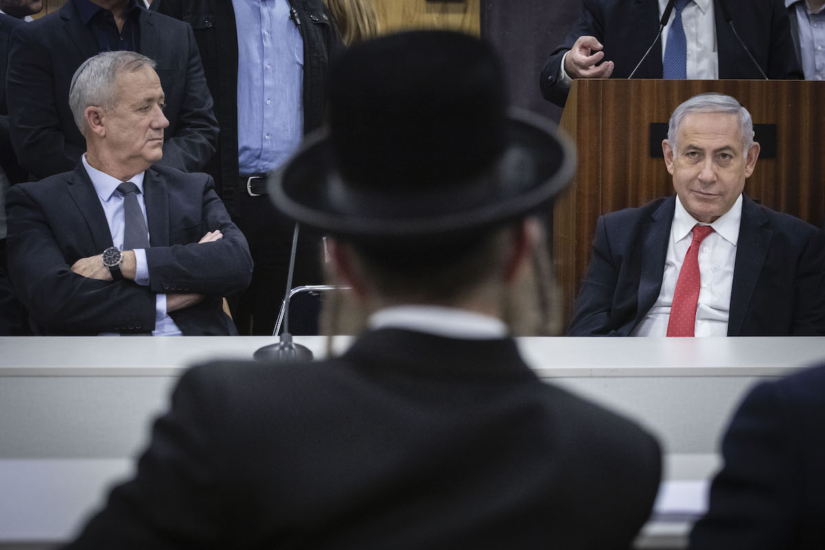 Shas party chairman and Minsiter of Interior Affairs Aryeh Deri, Prime Minister Benjamin Netanyahu, and Blue and White leader Benny Gantz at the Knesset in Jerusalem on November 4, 2019. (Hadas Parush/Flash90)
