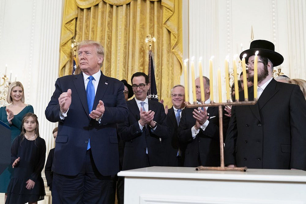 President Trump seen during the lighting of the Menorah during an evening Hanukkah Reception in the East Room of the White House, December 11, 2019. (Joyce N. Boghosian/White House)