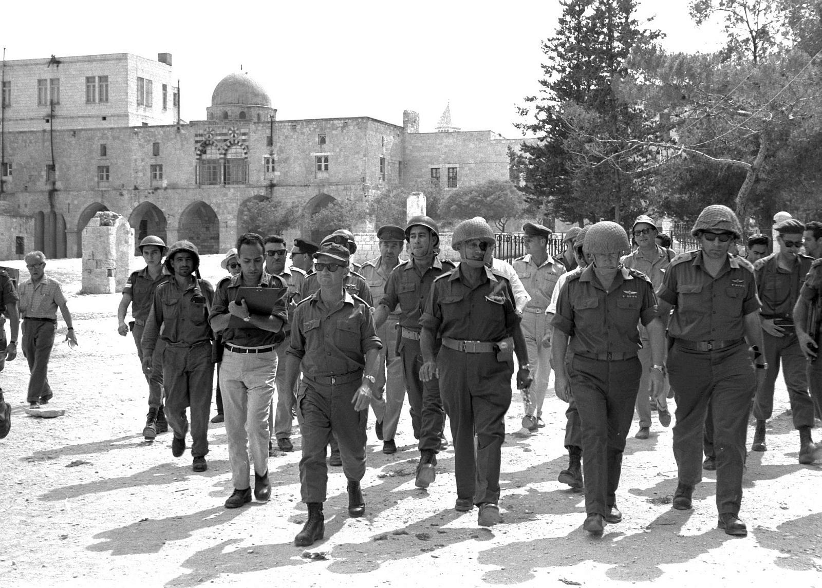 The Six Day War. Defense Minister Moshe Dayan, Chief of Staff Yitzhak Rabin, Gen. Rehavam Ze'evi (right) and Gen. Uzi Narkiss walk through the Old City of Jerusalem, June 7, 1967. (Ilan Bruner / GPO)