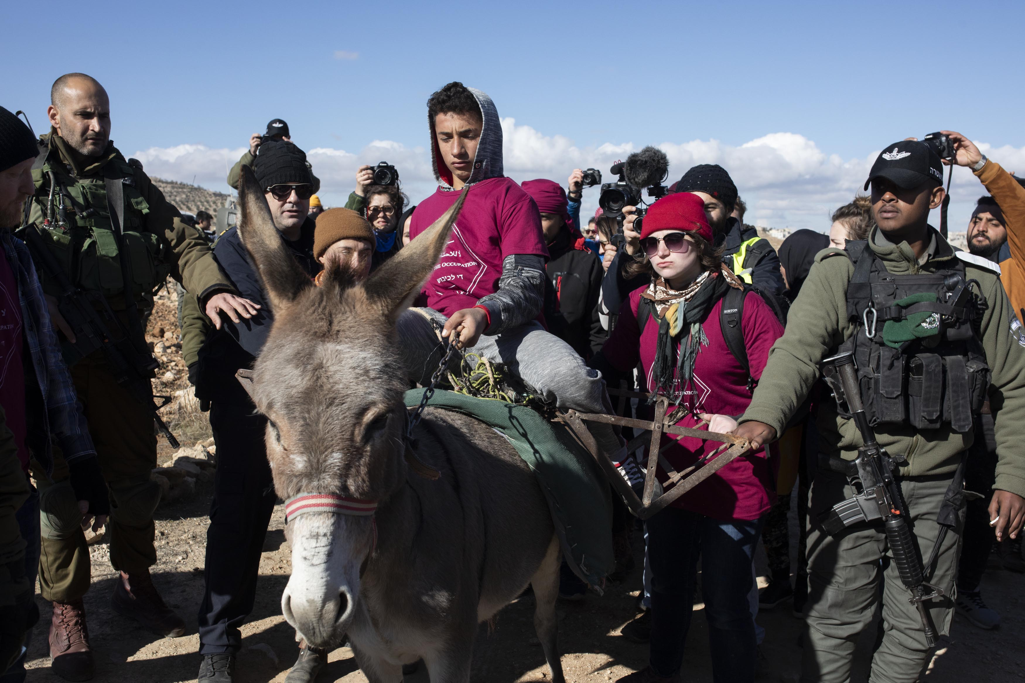Palestinian, Israeli, and international activists take part in a direct action to restore access to the Ein Albeida spring, South Hebron Hills, January 3, 2020. (Oren Ziv/Activestills.org)