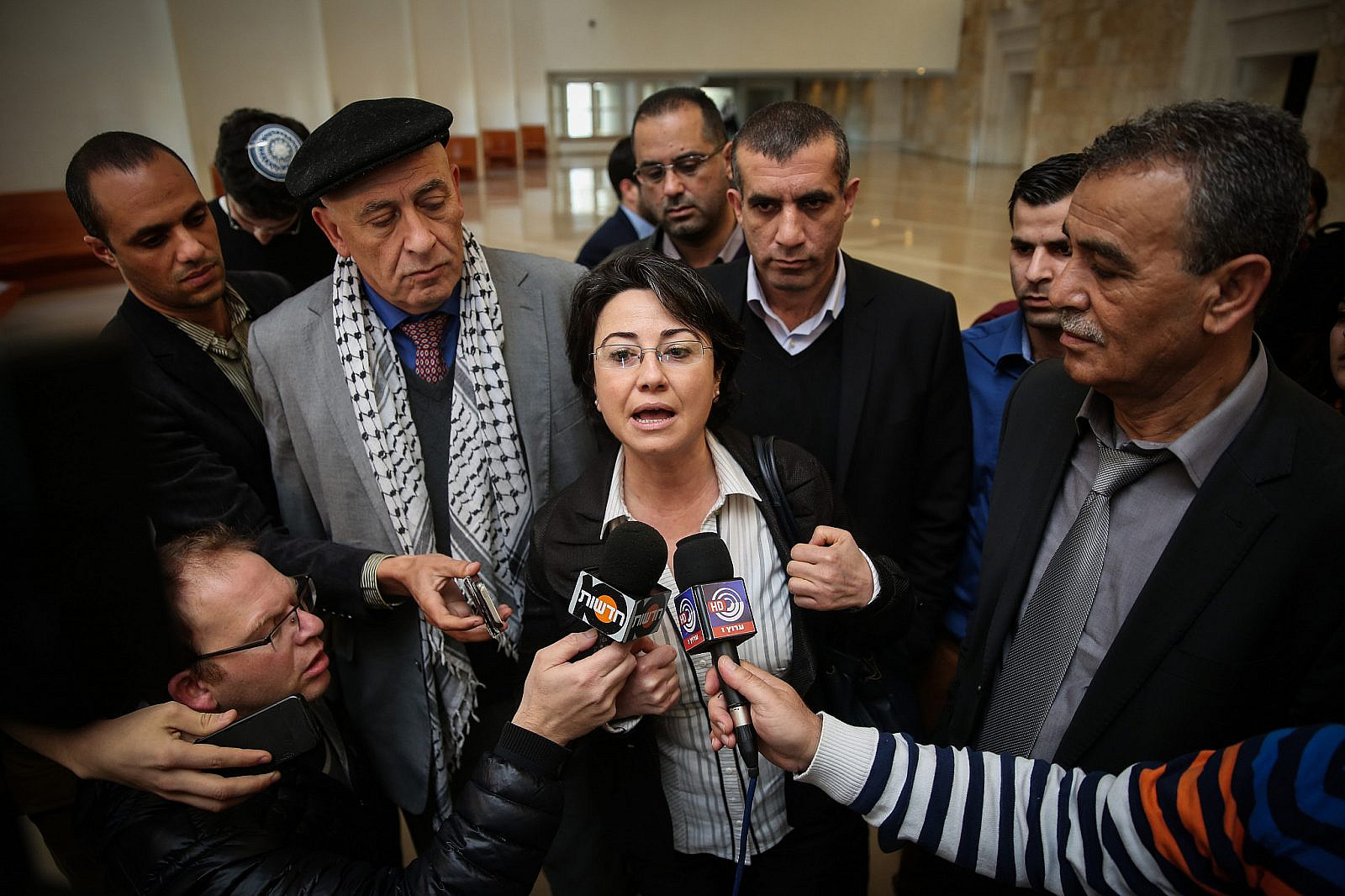 Arab Knesset member Haneen Zoabi speaks with press at the Supreme Court in Jerusalem where she appealed a decision by the Central Election Committee to disqualify her from running in the Israeli elections, February 17, 2015. (Hadas Parush / FLASH90)