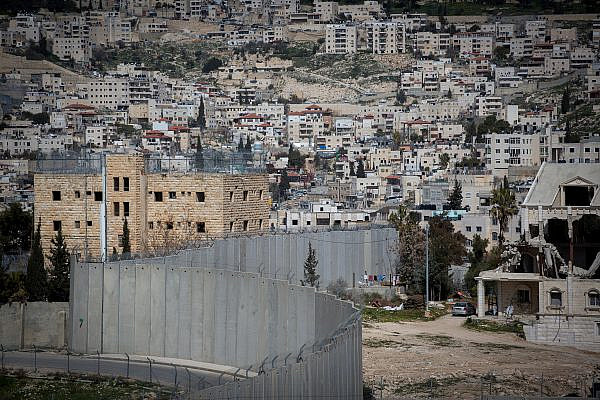 View of the separation wall as seen from the Palestinian town of Abu Dis. February 26, 2017. (Miriam Alster/FLASH90)