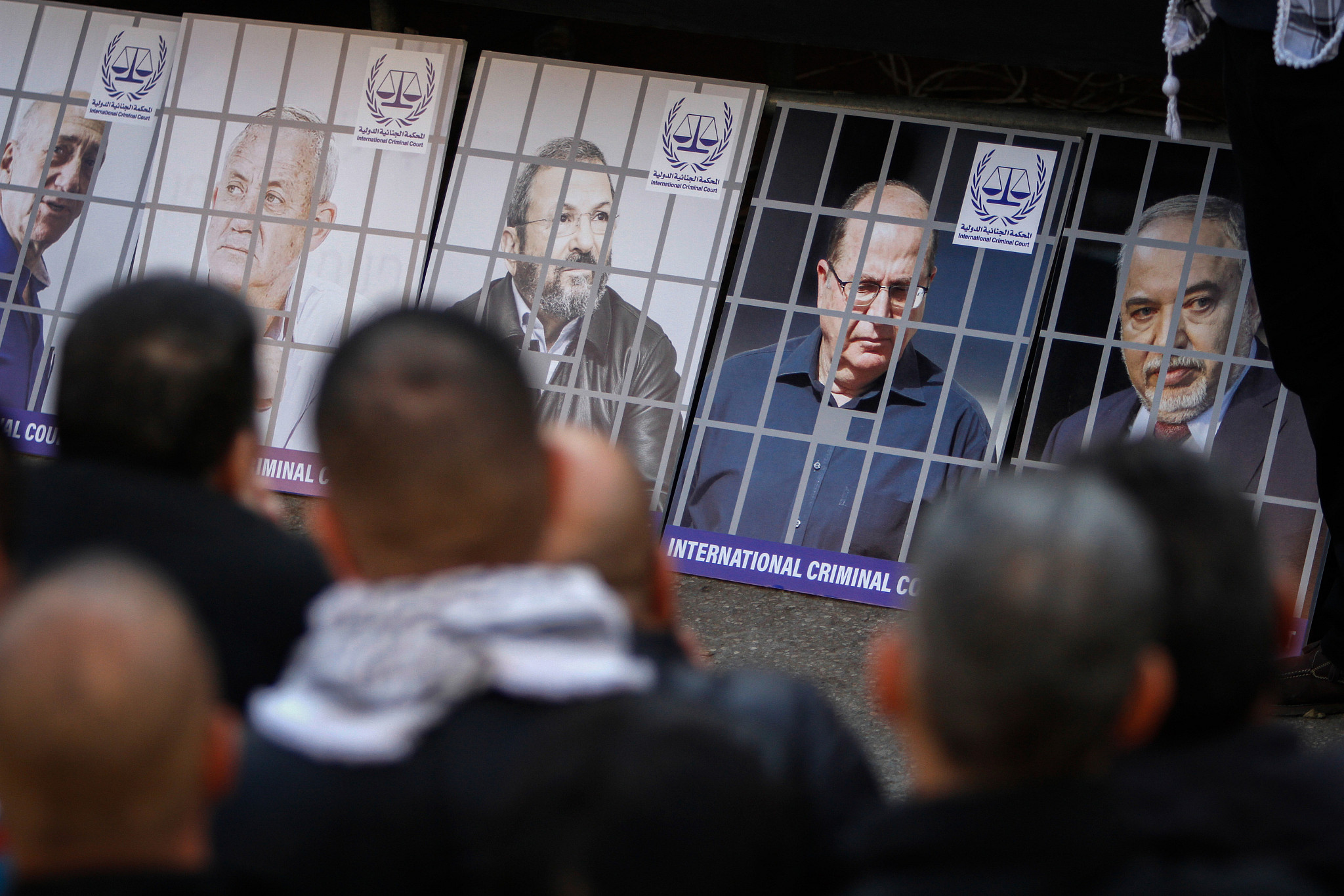 Palestinian demonstrators and Fatah supporters stand before the images of Israeli Prime Minister Benjamin Netanyahu and other Israeli leaders during a rally in the West Bank city of Nablus on January 6, 2020. (Nasser Ishtayeh / Flash90)