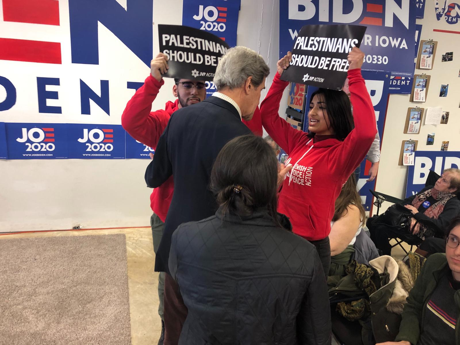 JVP Action activists interrupt former Secretary of State John Kerry at a campaign event supporting Joe Biden in Sioux City, Iowa, January 7, 2019. (Courtesy of Jewish Voice for Peace Action)