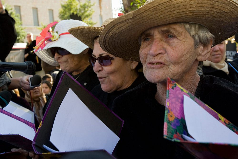 Hava Keller, right, takes part in a vigil marking the 20th anniversary of the Women In Black movement, Jerusalem, December 28, 2007. (Oren Ziv/Activestills.org)