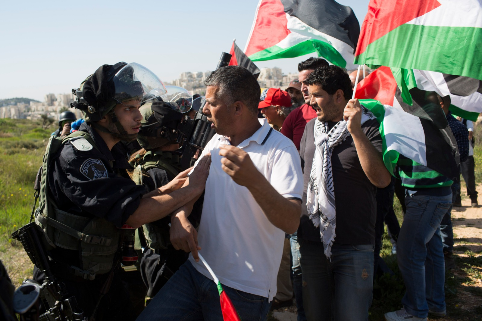 Muhammad Khatib during a weekly demonstration in the West Bank village of Bil'in in 2015. (Oren Ziv)