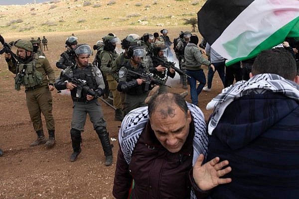Palestinian protesters clash with Israeli Border Police officers while demonstrating against Trump's 'Deal of the Century,' near the village of Tayseer in the occupied Jordan Valley, January 29, 2020. (Oren Ziv)